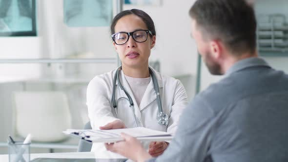Thumbnail for Positive Female Doctor Shaking Hands with Male Patient after Consultation
