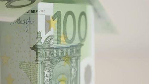 Mortgage investement metaphor  with 100 Euro banknotes 4K 2160p 30fps UltraHD footage - Improvisatio