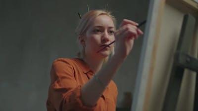 Talented Artist Drawing Artwork in Art Workshop