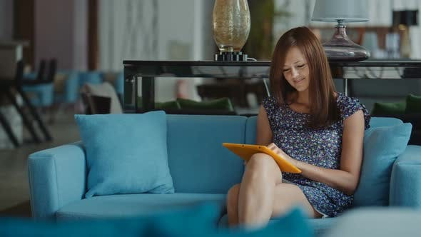 Thumbnail for Woman Using Tablet Pc in Hotel Lobby