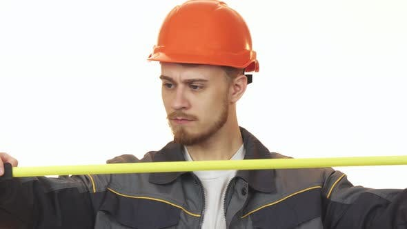 Thumbnail for Young Male Engineer Making Measurements Isolated