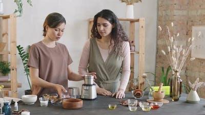 Women Grinding Coffee Beans In Blender