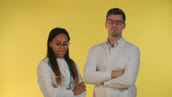 Thumbnail for Multiracial Woman and Man in Lab Coat Showing That They Are Agree with Something