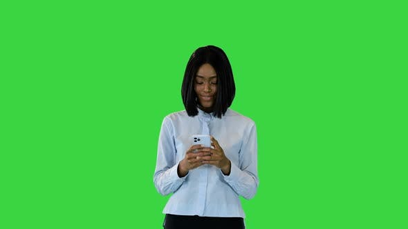 Young African Girl with Smartphone Female Happy Smiling Messaging with Friends Via Mobile Phone App