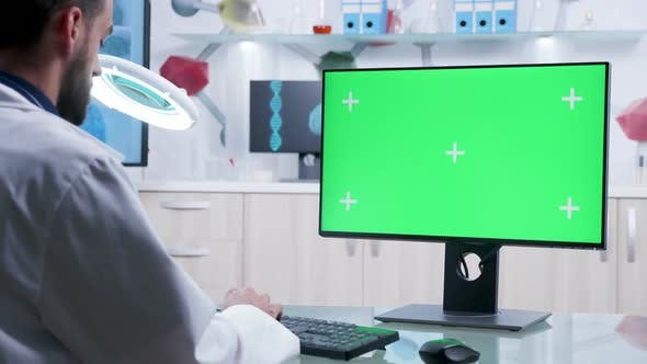 Thumbnail for Doctor Is Typing on Computer Keyboard with Green Screen