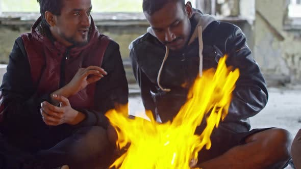 Thumbnail for Arab Men Warming by Fire in Abandoned Building