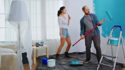 Joyful Couple Redecorating