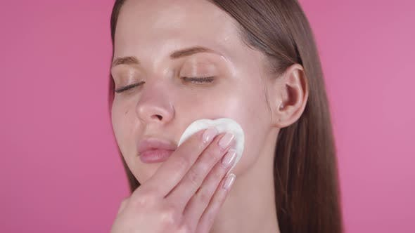 Thumbnail for Attractive Young Woman Wiping Face with Cotton Pad