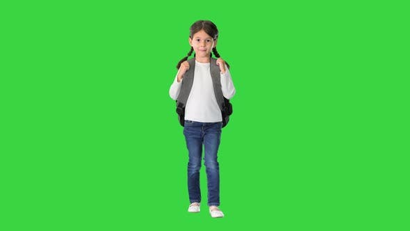 Thumbnail for Smiling Little Girl Walking To School with a Backpack on a Green Screen, Chroma Key