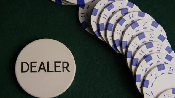 Rotating shot of poker cards and poker chips on a green felt surface - POKER 055