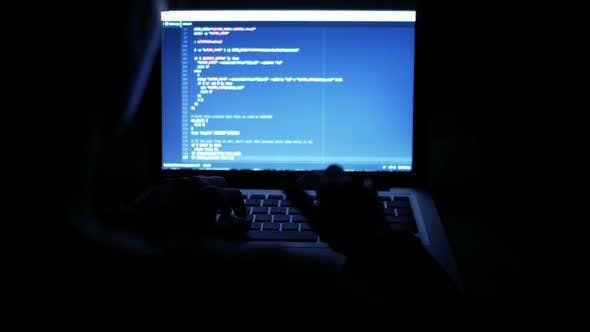 Thumbnail for Programmer Typing Code At Night