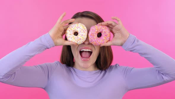 Thumbnail for Woman Posing for Camera with Two Donuts