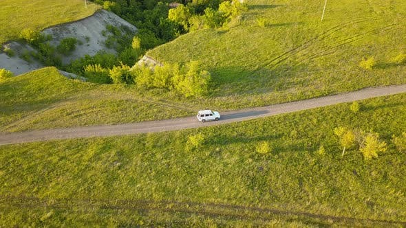 Thumbnail for Car On Country Road Near Ravines