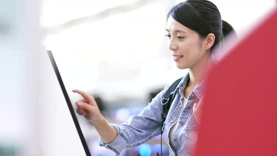 Thumbnail for Woman using selfie check in machine in the airport