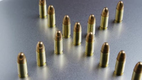 Cinematic rotating shot of bullets on a metallic surface - BULLETS 036