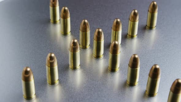 Thumbnail for Cinematic rotating shot of bullets on a metallic surface - BULLETS 036