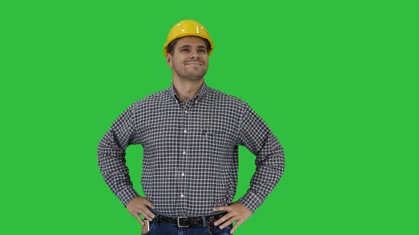 Cover Image for Smiling construction worker in yellow helmet looking at