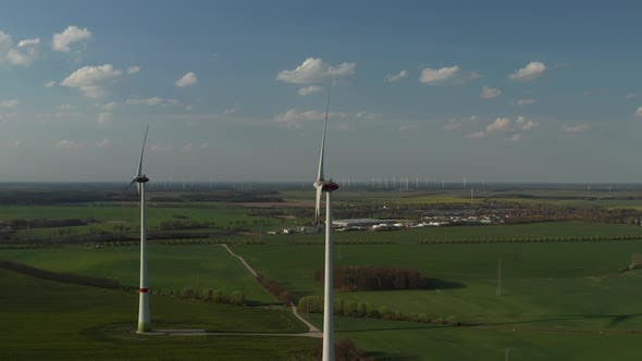 Thumbnail for AERIAL: View of Windmills Farm for Energy Production on Beautiful Blue Sky Day with Clouds. Wind