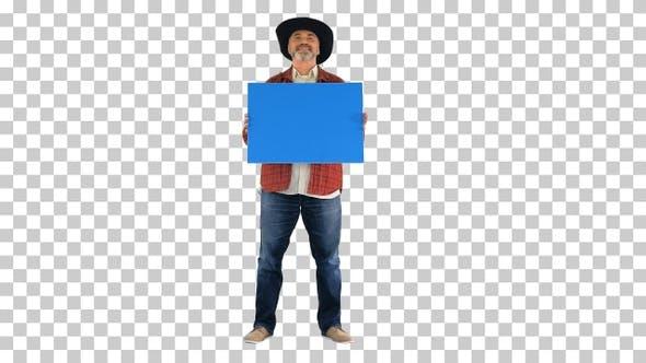 Senior farmer in a hat holding blank placard, Alpha Channel