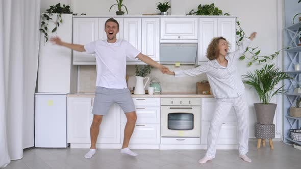 Thumbnail for Young Couple Dancing On Kitchen At Home