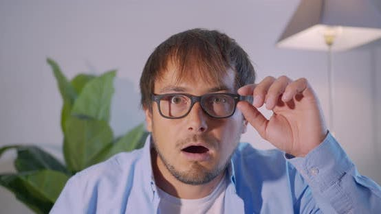 Thumbnail for A Man in Surprise Shoots Glasses and Looks at the Camera in Surprise. Businessman Shocked.