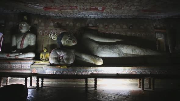 Thumbnail for DAMBULLA, SRI LANKA - FEBRUARY 2014: Big reclining Buddha at the Golden Temple of Dambulla. The Gold