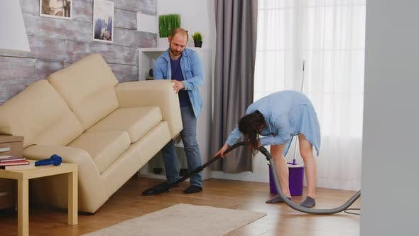 Thumbnail for Man Pick Up Sofa for Cleaning