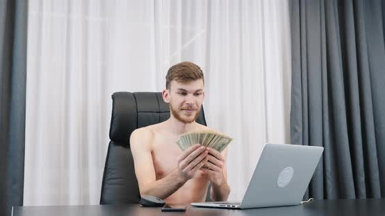 Thumbnail for Rich successful man counting cash money in modern office, Success business concept