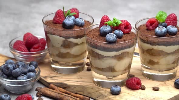 Thumbnail for Tiramisu Dessert with Blueberries and Raspberries in a Glass on Wooden Cutting Board