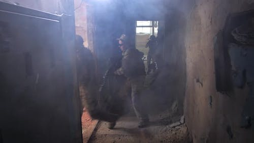 Armed Fighters Cleaning Building From Enemy Forces