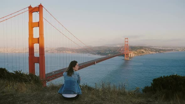 Thumbnail for Back View Young Local Woman Sitting Alone at Epic Scenery Meditating at Beautiful Sunset View