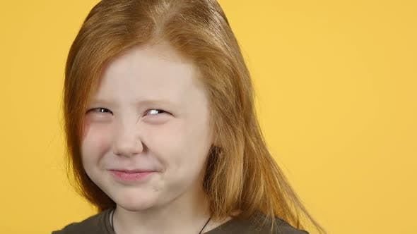 Thumbnail for Close-up Little Red-haired Girl Showing Emotion Punishment, Slow Motion