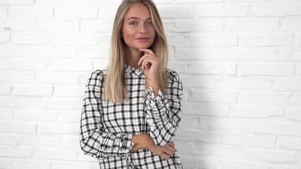 Blond Woman In Checked Top