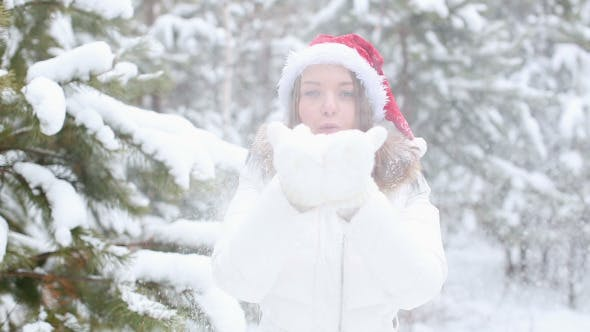 Thumbnail for Happy Friendly Woman Blowing Snowflakes