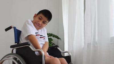 Disabled boy in a wheelchair.