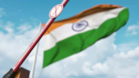 Thumbnail for Barrier with STOP CORONAVIRUS Sign Being Closed Near Flag of India