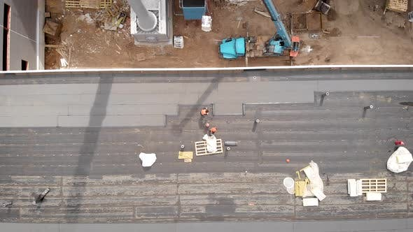 Thumbnail for Workers at a Construction Site. The Process of Hydro Insulation of the Roof. With the Help of a
