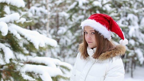 Thumbnail for Sad Woman in a Cap of Santa Claus