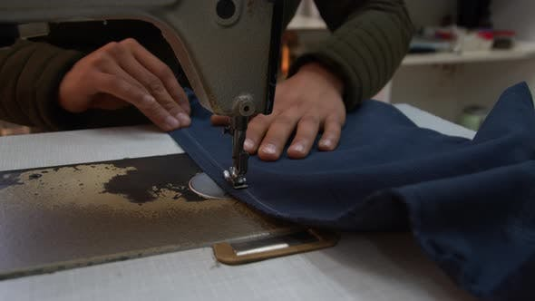 Tailor Sews Trousers On The Sewing Machine 1