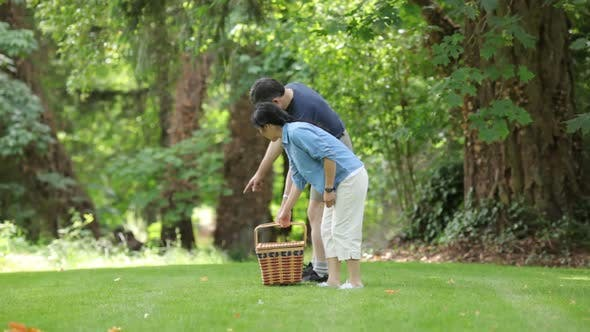 Thumbnail for Mature Asian couple preparing for a picnic