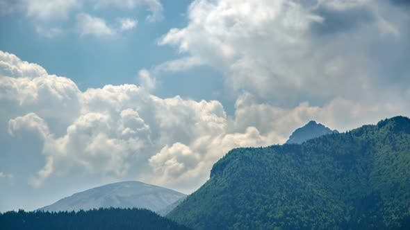 Thumbnail for Clouds above Green Forest Mountains Landscape in Spring Nature