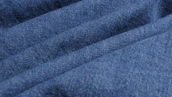 Thumbnail for Blue classic denim surface gathers close-up 4K 2160p 30fps UltraHD tilting footage - High quality  j