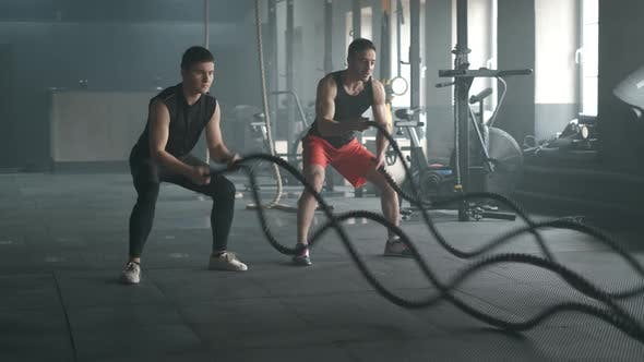 Athletes Working Out with Battle Ropes at Gym.  50Fps Footage