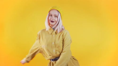 Beautiful Woman with Pink Hair and Piercing Dancing Meme Dance on Yellow
