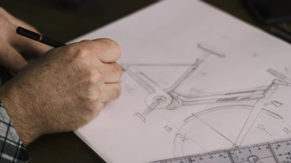 Thumbnail for Designer Drawing Plans For A Bicycle