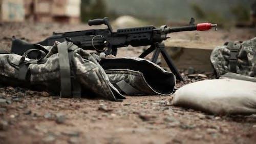 Ground level tracking shot of M240 machine guns.