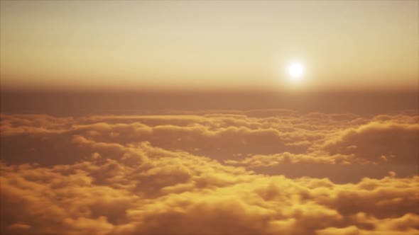 Flight through clouds in evening or morning