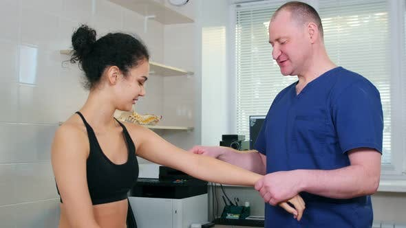 Doctor Specialist Testing Out the Reaction on Wartenberg Wheel on body