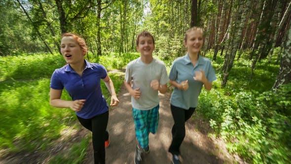 Teenagers Jogging in Wood Park