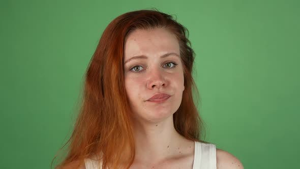 Cover Image for Angry Red Haired Woman on Green Chromakey